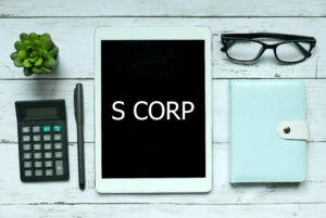 Business,concept.,top,view,of,plant,calculator,glasses,pen,notebook,and,tablet,written,with